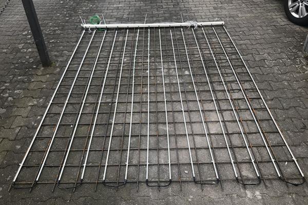 Bewehrungsstäbe aus glasfaserverstärktem Kunststoff mit integriertem Heizdraht zur Energieerzeugung im Betonspeicher