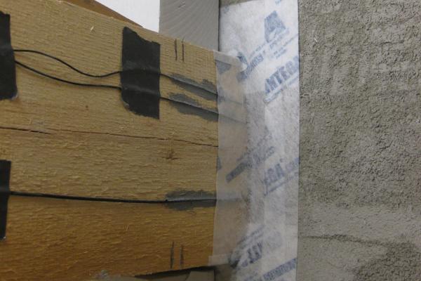 Einbaudetail: Anschluss des Holzbalkens an die Innendämmung